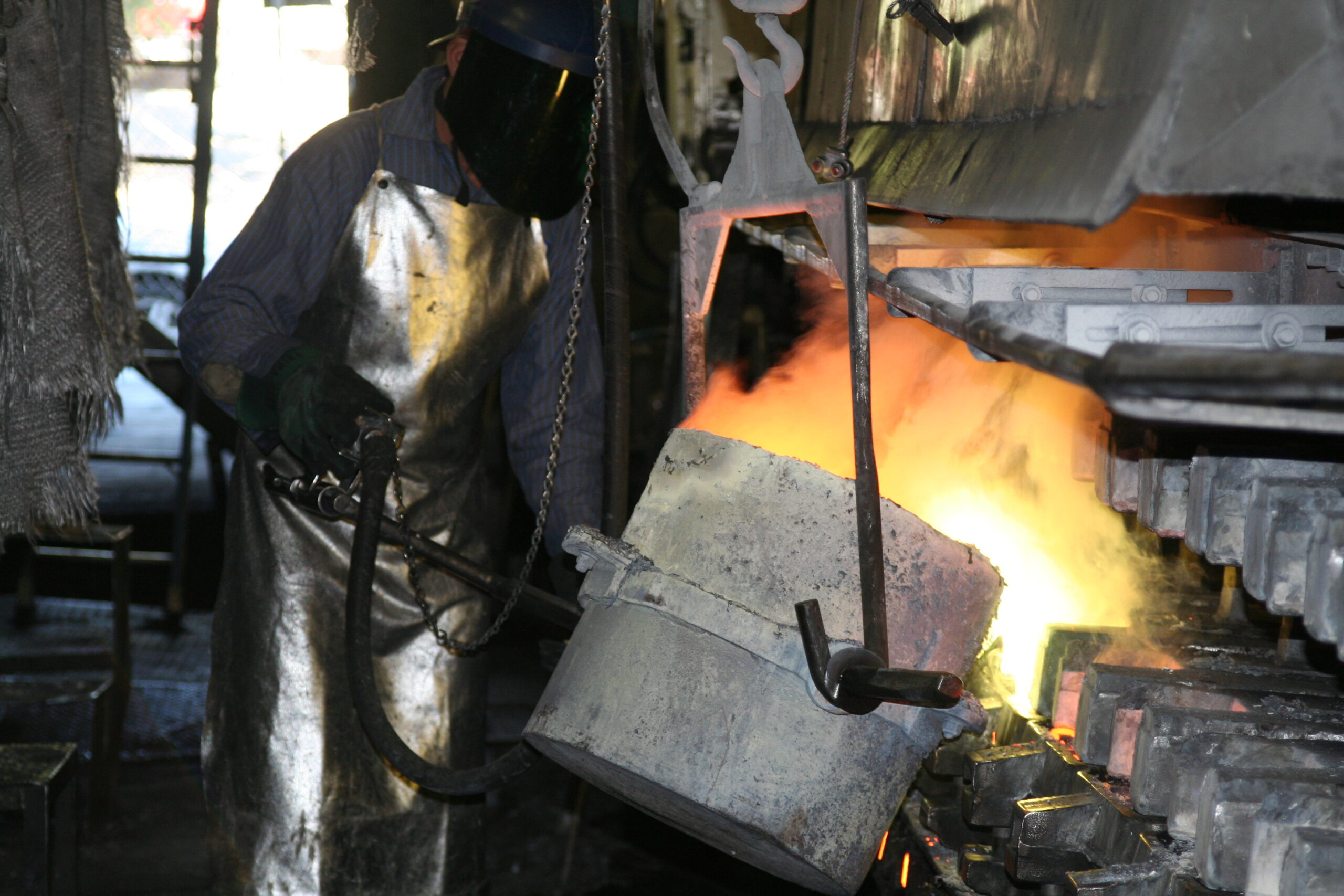 Arrowhead Brass Foundry Worker Pouring Hot Metal